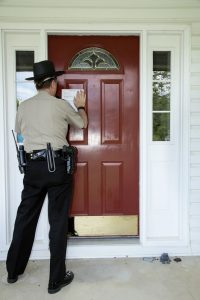 Officer Posting an Eviction